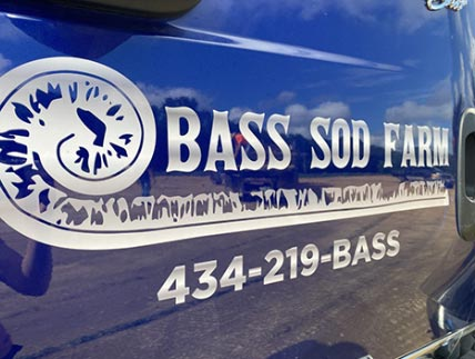 Bass Sod Farm Logo on side of blue truck in white text with phone number 434-219-BASS